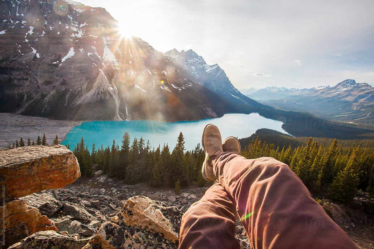 Relaxing on cliff near lake