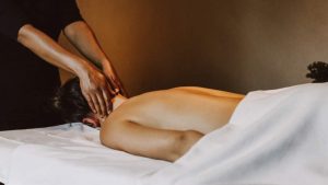 Men Massaging Neck of Person on Table