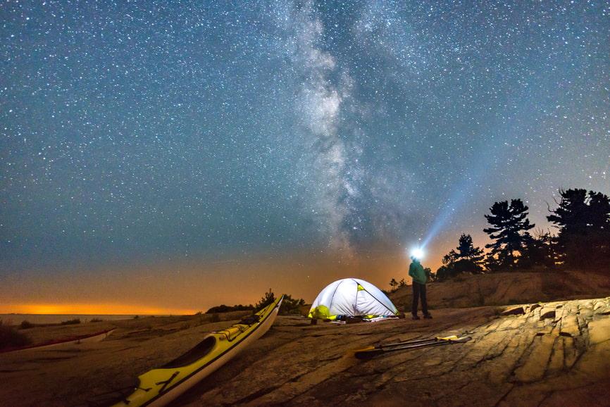 Camper with Kayak Stargazing
