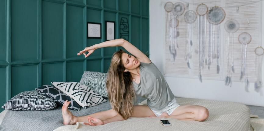 Woman Doing Yoga On Headphones