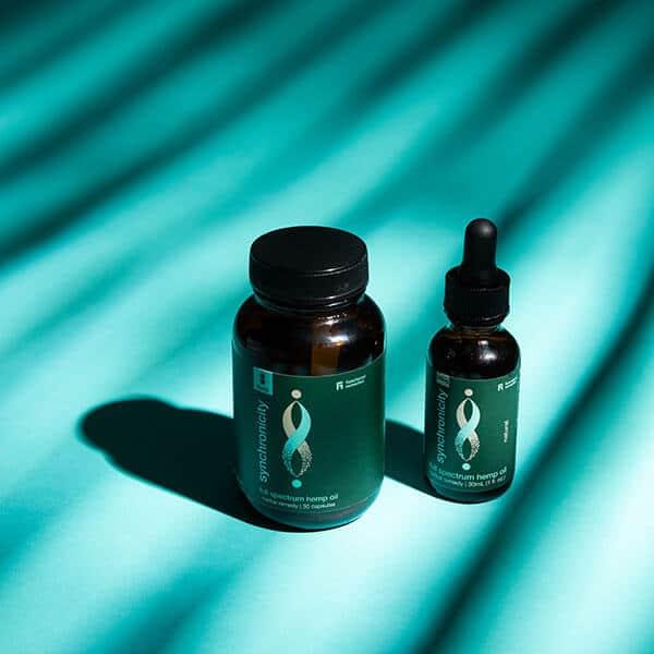 30 Capsule Bottle next to 500mg tincture – Full-Spectrum Hemp Oil