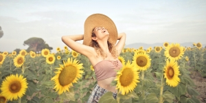 Woman Rejoicing in Sunflower Field