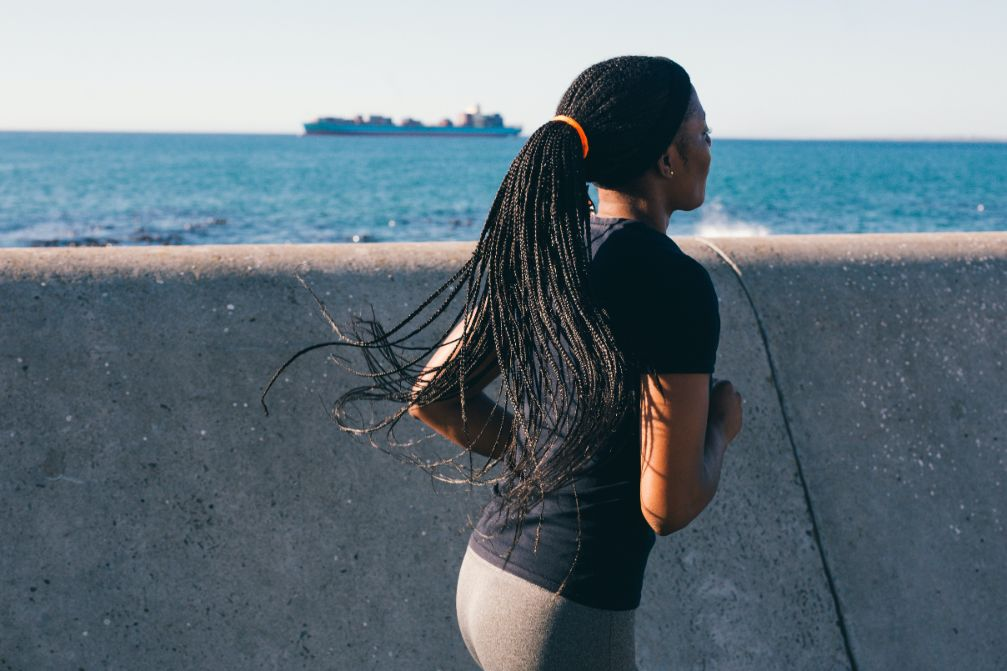 photo-of-woman-running-near-sea-wall