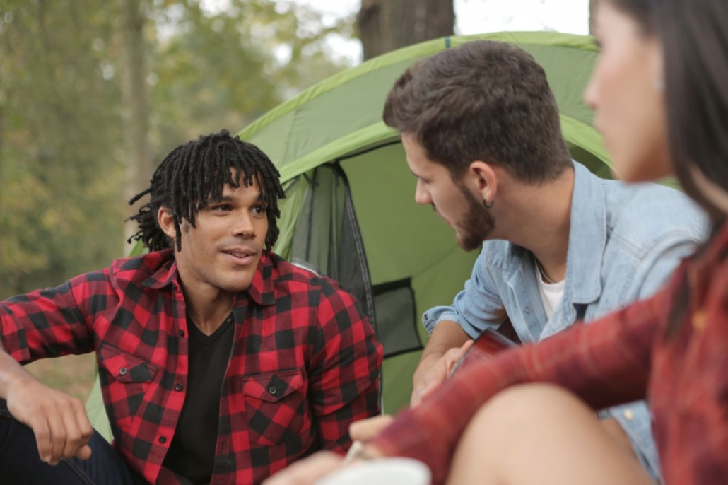 multiethnic-young-people-talking-at-campsite