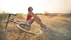 CBD topicals help this athlete relax after a long bike ride. CBD topicals for sale at Synchronicity Hemp Oil