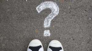 Chalk question mark with shoes