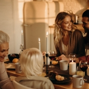 Family talking around holiday dinner table