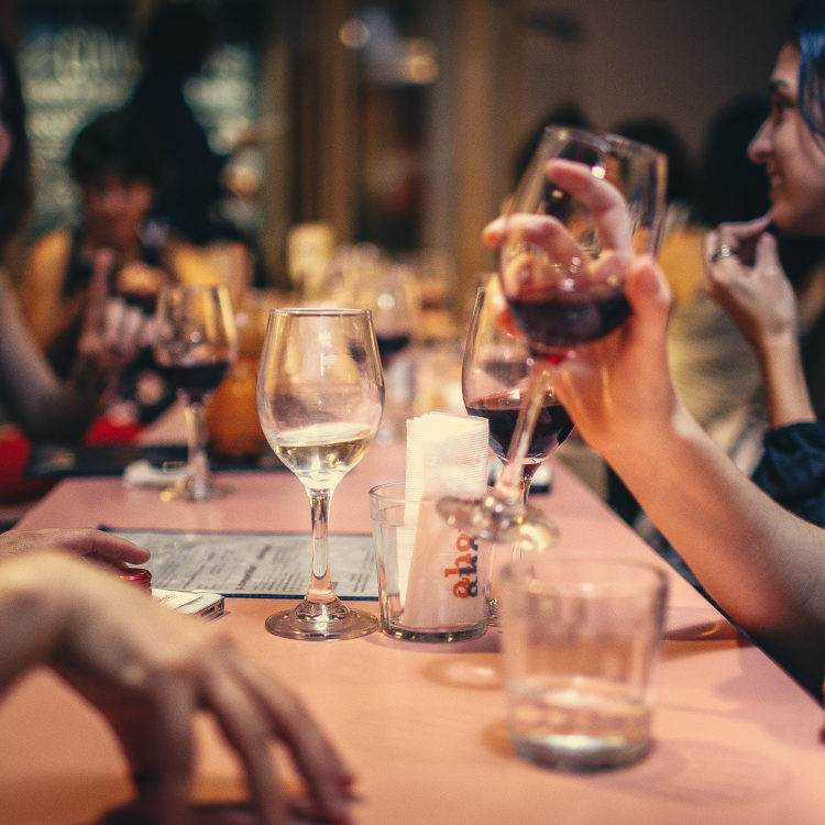Hands holding glasses of wine. Wine is a holiday staple, used almost the world over. CBD doesn't have this trend yet, but maybe in time, holiday parties and family get togethers will become synonymous with taking some CBD oil, or mixing a tincture into your drink!