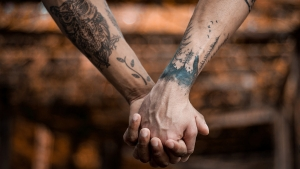 Tattoo Arms Holding Hands