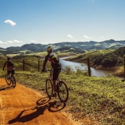 Two bicyclists riding dirt road