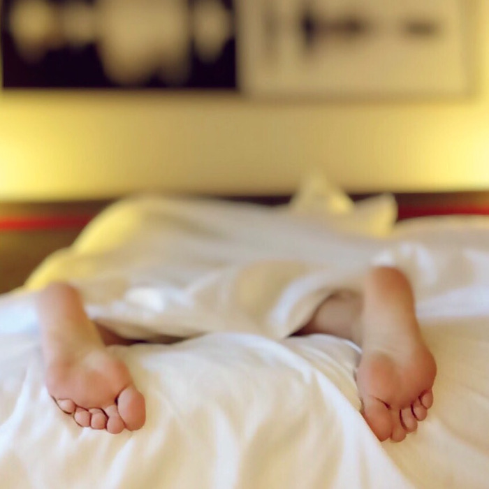 Feet sticking out of sheets