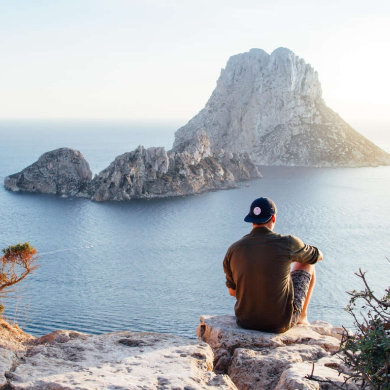 Man looking over water to islands relieves stress
