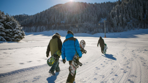 Snowboarders walking