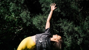 Woman Practicing Yoga Outdoors after taking CBD capsule. CBD Capsules for Yoga at Synchronicity hemp oil