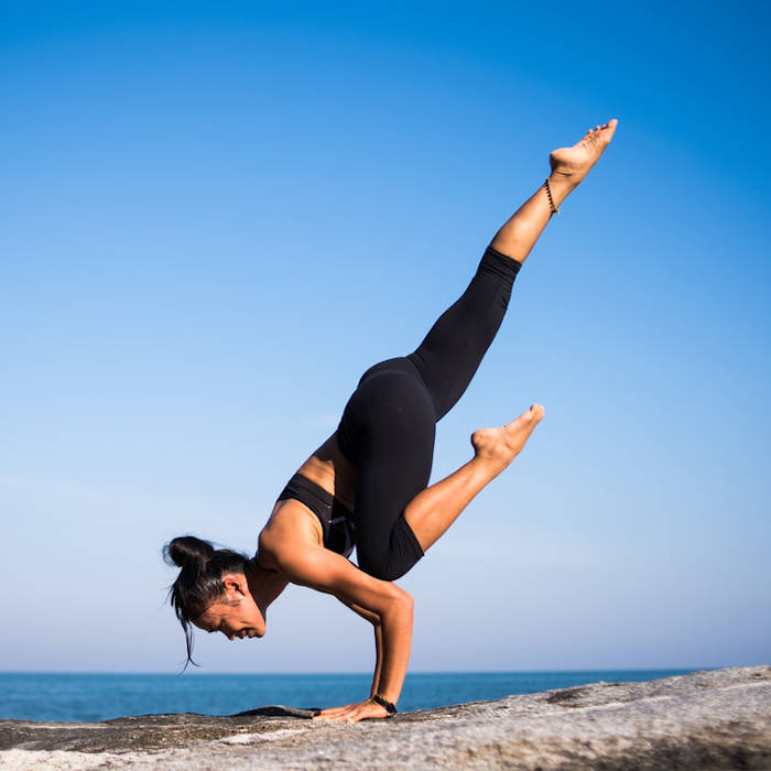 This very strong lady probably has years of conditioning allowing her body to perform in unique ways. CBD can also affect the body in unique ways. Try some after hot yoga CBD muscle rub to cool down.